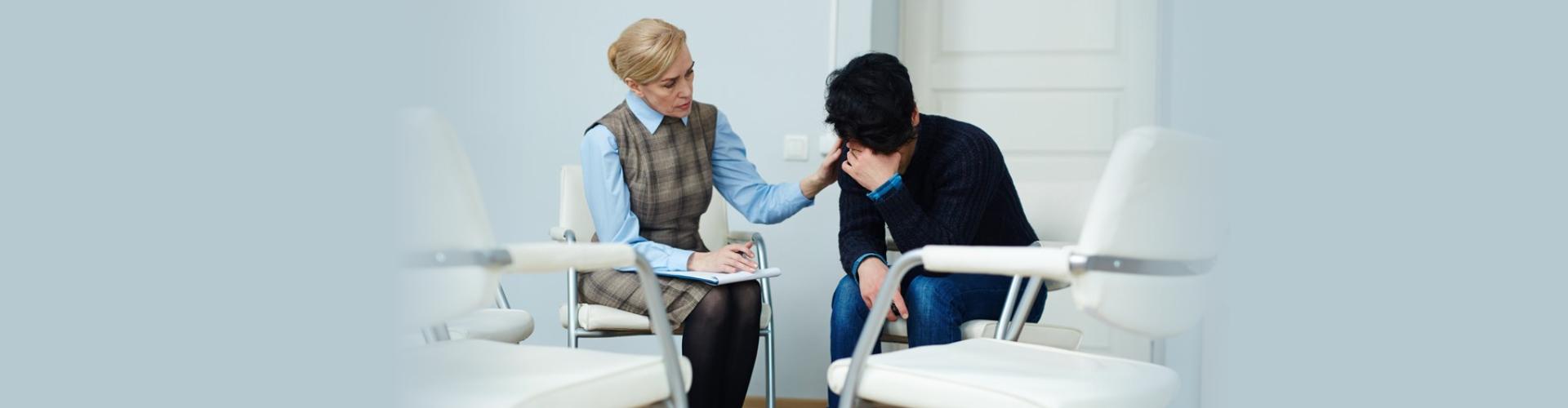 psychiatrist comforting the boy